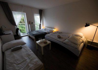 Rozložené pohovky v apartmánu Bratislavská