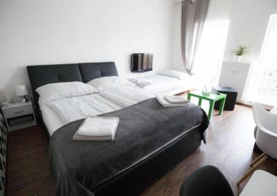 Obytná místnost s postelí